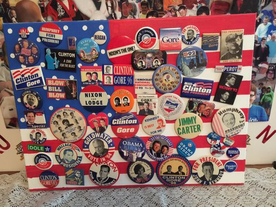 A number of political pins Corey Foister collected as a child.